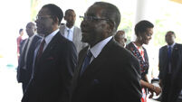 Robert Mugabe returns to Zimbabwe looking fit after holiday