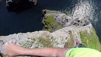 Watch Iain Miller free solo 100 metre high Donegal sea stack