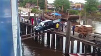WATCH: These guys try to load a pick-up onto a boat using just two planks