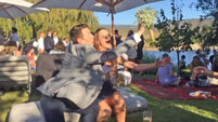 This guy  physically stopped his date from catching the bouquet at a wedding
