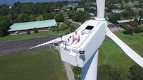 WATCH: Drone catches man sunbathing on top of huge wind turbine