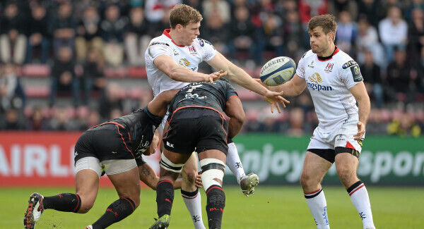 Andrew Trimble is tackled by Yacouba Camara and Thierry Dusautoir as he lays the ball off to team-mate Louis Ludik. Picture credit: Oliver McVeigh/SPORTSFILE