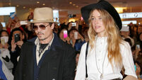 Australia charges Johnny Depp's wife after doggie debacle