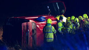 Man injured after van leaves road and overturns in field