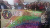 Residents brave rain to gather for anti-racism protest in Rathfarnham
