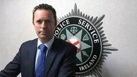 PSNI reveal wife of father-of-four had tried to save him after paramilitary-style killing in Belfast
