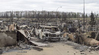 Oil workers ordered to evacuate as Canada wildfire spreads