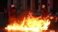 Bill introduces taxes for most Greeks; anarchists clash with police on the streets of Athens
