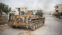Ceasefire agreed in rebel-held suburb of Syrian capital