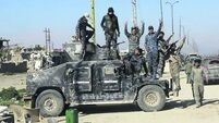 Iraqi forces bid to dislodge IS from area north of Baghdad as four suicide bombers strike