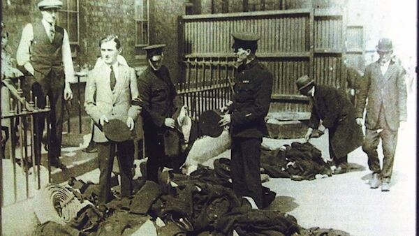 Members of the Royal Irish Constabulary dump their uniforms as the force is disbanded in 1922. Picture: Leargas