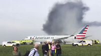 Dramatic video shows passengers escape burning American Airlines plane