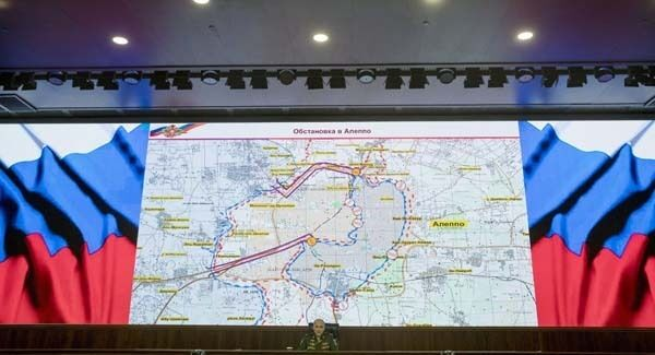 Lt. Gen. Sergei Rudskoi of the Russian military's General Staff speaks to the media, with a map of the area around Aleppo seen in the background, at the Russian Defense Ministry's headquarters in Moscow, Russia, yesterday