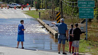 Flood fears continue despite departure of Hurricane Matthew from US
