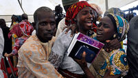Parents reunited with 21 girls freed by Boko Haram