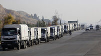 Aid arrives at besieged rebel-held Syrian suburb