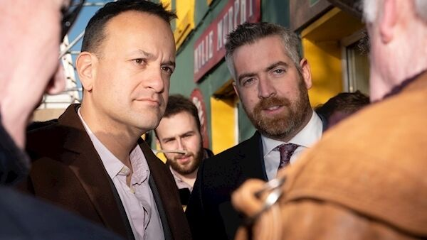 Leo Varadkar and Christoper O'Sullivan, Cork County Mayor and Fianna Fail candidate whose paths crossed while canvassing with Senator Tim Lombard in Kinsale on Saturday listen to the concerns of a constituent. Picture. John Allen