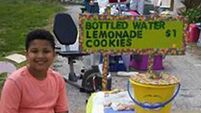This American boy set up a lemonade stand to fund his own adoption