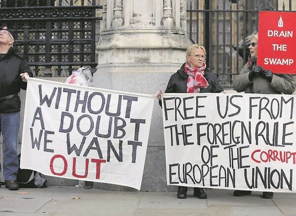 Pro-Brexit demonstrators outside parliament this week. A survey shows the share of British respondents who aren't sure if they would miss the EU is 63%. Picture: Luciana Guerra