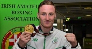 29 June 2015; Michael O'Reilly, Men's Boxing Middle 75kg gold, Team Ireland, holds up his gold medal on his return from the 2015 Baku European Games. Terminal One, Dublin Airport. Picture credit: Cody Glenn/SPORTSFILE