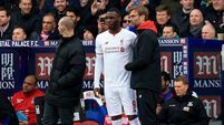 Christian Benteke's controversial late penalty gives 10-man Liverpool win at Palace