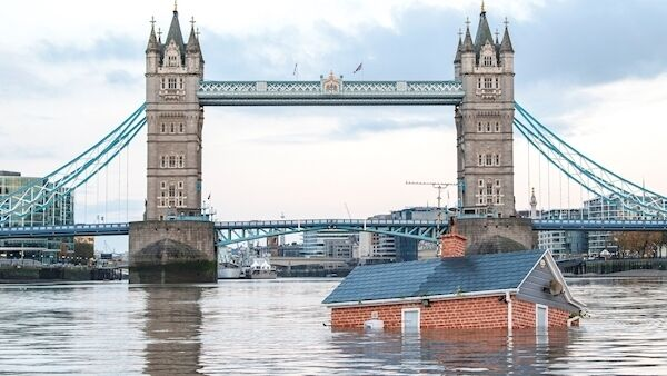 "Extinction Rebellion who have floated a ""sinking house"" down the River Thames in London to highlight the impact of rising sea levels. PA Photo. Issue date: Sunday November 10, 2019. (Guy Reece/Extinction Rebellion/PA)"