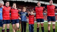 Tony and Dan Foley, sons of the late Anthony Foley sing with the Munster players after the game 22/10/2016