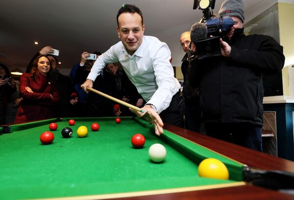 Leo Varadkar plays pool in 'The Midland Bar' while on the campaign trail in Enfield, Co. Meath. Picture: Brian Lawless/PA Wire
