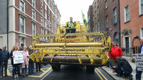 Latest: Farmers take to Dublin streets in combine harvester as protest continues