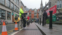 Dublin cyclists form human barrier in  third week of protest