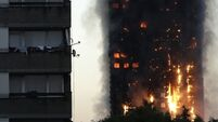 Residents describe being woken by screaming as fire hit London tower block