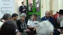 Theresa May heckled during visit to site of London mosque attack