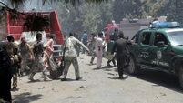 Suicide bomb near Afghan bank kills at least 29 people collecting wages ahead of Muslim holiday