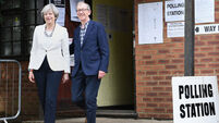 May and Corbyn cast votes as British election polling gets underway