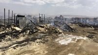Blaze destroys Syrian refugee camp in Lebanon and kills at least one