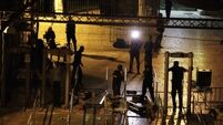 Israel removes metal detectors from holy site to defuse violence