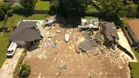 Two homes and boat fall victim to expanding US sinkhole as residents flee area