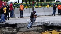 Father and son die after sinkhole swallows their car in Mexico