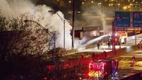 Police arrest three over fire that collapsed overpass which carries 400,000 cars a day in Atlanta