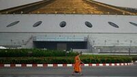 Police at Thai temple step up hunt for monk wanted for money laundering