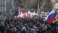 Thousands march in Moscow to remember gunned down Russian opposition leader Boris Nemtsov