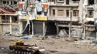 Syrian warplanes pound rebel-held area in Homs