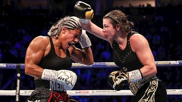 Katie Taylor in action with Christina Linardatou. Photo: INPHO/Gary Carr