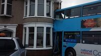 Double-decker bus smashes into side of house after collision with 4x4