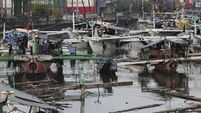 Typhoon leaves four dead on Christmas Day