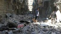50,000 flee as opposition hold weakens in Aleppo