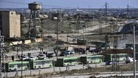 Buses leave two Syrian villages after Aleppo deal struck
