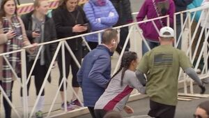 Watch fellow runners come to rescue as woman struggles to reach half-marathon finish line