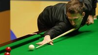 Defending champion Judd Trump cruises past Ashley Hugill in Beijing
