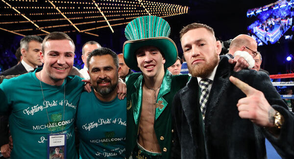 Michael Conlan celebrates with Matthew Macklin, Manny Robles and Conor McGregor. Pic: INPHO/Tom Hogan